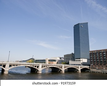 Grand Rapids Michigan USA beautiful downtown with large skyscrapers. The Grand River flows through the town.