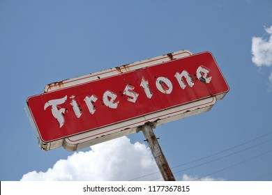 Grand Saline, TX - August 4, 2012: Vintage Firestone Neon Sign in Historic Downtown Grand Saline named for large salt deposits near town.