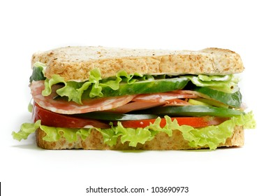 Grand  Sandwich with ham, lettuce, cucumber, tomato and salad isolated on white background