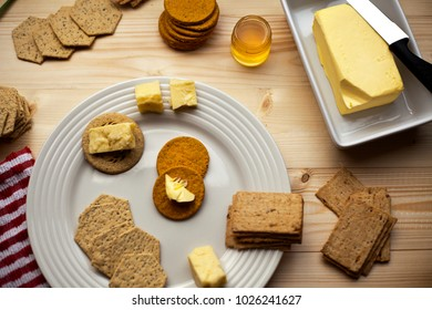 A grand selection of luxury crackers and cheese with organic honey