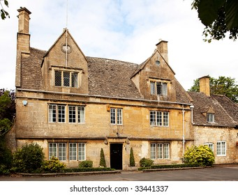 A grand stone built manor house in the cotswolds, England