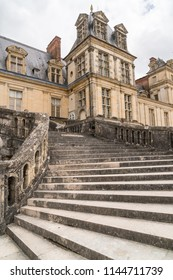 Grand stone stairs to an old medieval European castle at Fontainebleau