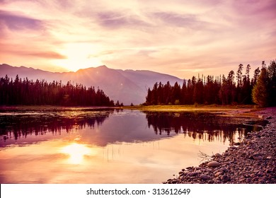 Grand Teton mountain range at sunset, Jackson Lake, Grand Teton National Park, wyoming, USA
