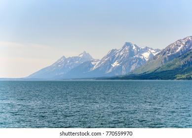 Grand Teton Mountains with lake in foreground