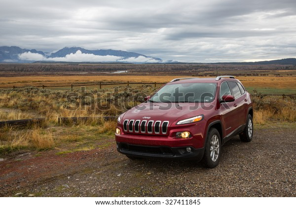 Grand Teton National Park, USA - October 1, 2015: View of  a 2015 Jeep Cherokee, a popular SUV in the United States.