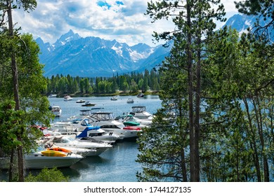 Grand Teton National Park, Wyoming, USA-July,15,2016. Beautiful  view of lake with boats and yachts docked and high mountains in the background.