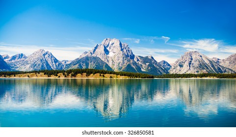 Grand Teton National Park, Wyoming.  Reflection of mountains on Jackson Lake near Yellowstone.