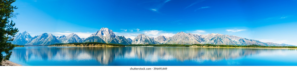 Grand Teton National Park, Wyoming.  Panorama showing reflection of mountains on Jackson Lake near Yellowstone.