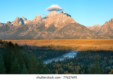 Grand Teton National Park in Wyoming from the Snake River overlook. Cloud hanging over Grand Teton resembles a western hat.