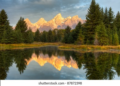 grand teton peaks reflection during sunrise