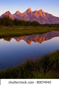 Grand Teton sunrise reflecting in beaver pond at Schwabacher Landing