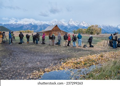 GRAND TETON, WY, USA - OCTOBER 2: Photographers gather to capture the sunrise at Mormon Row on October 2, 2014 in Grand Teton. The view of the old barns at Mormon Row and the Tetons is spectacular.