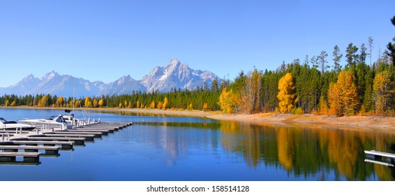 Grand Tetons and Jackson lake in autumn time