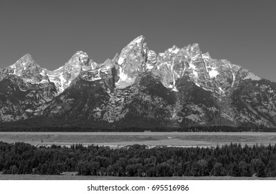 The Grand Tetons range and peaks in a black and white version, located inside the Grand Teton National Park, Wyoming, United States of America (USA).