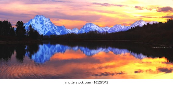 The Grand Tetons reflecting in the Snake River from Oxbow Bend - Grand Teton National Park, Wyoming.