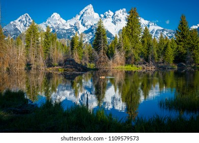 Grand Tetons scenic classic mountain landscape with snake river reflection