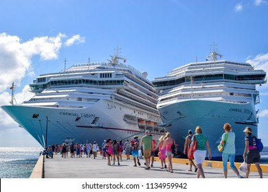 Grand Turk, Turks and Caicos Islands - April 03 2014: Cruise passengers departing/ on departure from a Caribbean vacation to Carnival Liberty and Carnival Victory Ships at Grand Turk Cruise Terminal.