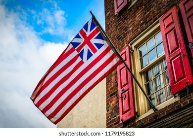 The Grand Union Flag, also called the Continental Colors, Congress Flag, Cambridge Flag, or First Navy Ensign is generally considered the first flag of the USA.