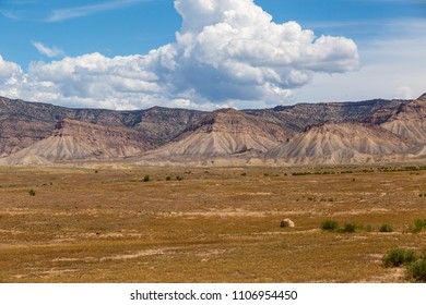 Grand Valley Colorado Book Cliffs on a partly cloudy day spring of 2018