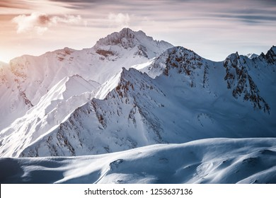 Grand view over steep slopes on a sunny winter day. Location place famous ski resort Silvretta Arena Ischgl/Samnaun on the Swiss Austrian border. State Tyrol, Europe. Discover the beauty of earth.