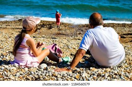 Grandad Grandkids on the Beach
