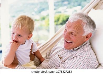 Grandad with grandson in a hammock