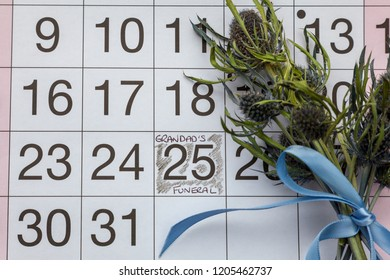 Grandad's Funeral written on a calendar page and a posy of thistles