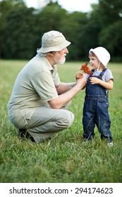 Grandchild and grandfather having fun outdoor
