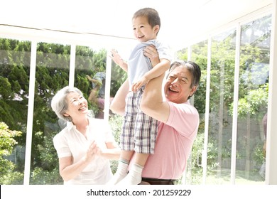 A granddad taking care of his grandson