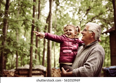 Granddaughter with cute little granddaughter  enjoying in the woods.