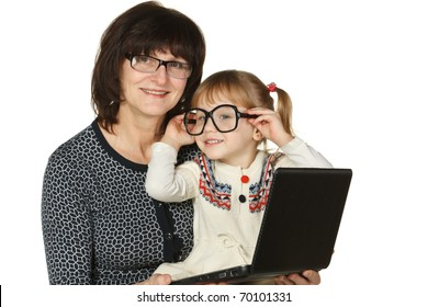 Granddaughter fooling with grandmother's glasses isolated on white