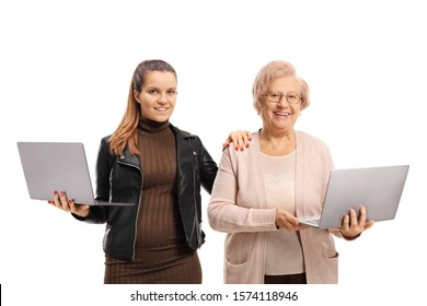 Granddaughter and grandmother holding laptop computers isolated on white background