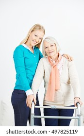 Granddaughter helping old senior woman at home