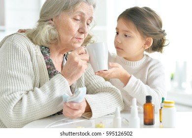 Granddaughter takes care of a sick grandmother