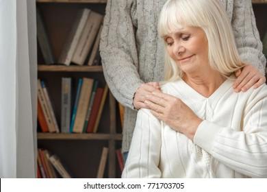 Granddaughter taking care of her retired grandmother love