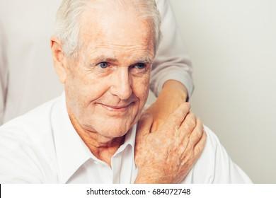 Granddaughter Taking Care of Senior Grandfather
