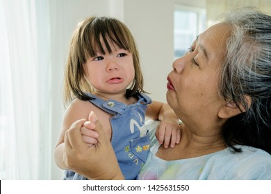 Granddaughter who is cared for by her grandmother. She was crying, lamenting the need for the caretaker and her grandmother was doing.