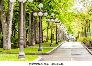 Grande Allee sidewalk with row of lantern light lamps during day with nobody in Quebec City, Canada