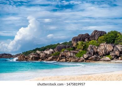 Grande Anse beach, La Digue island, Seychelles. Amazing natural landscape of paradise island and impressive clouds