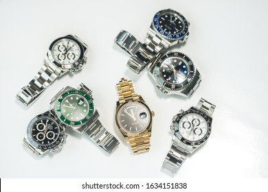 Grande Praire, Canada - July 17, 2017: Collection of Luxury Rolex watches on white background