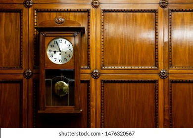 Grandfather clock in wooden case. wood Background. Pendulum wall clock.