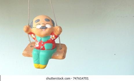 grandfather doll statue