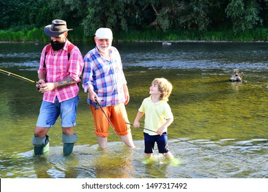 Grandfather, father and son are fly fishing on river. Happy grandfather, father and grandson with fishing rods on river berth. Man teaching kids how to fish in river