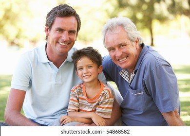 Grandfather With Father And Son In Park