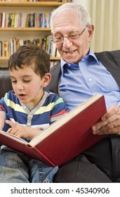 grandfather and grandchild reading a book