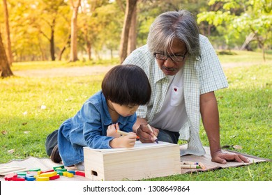 grandfather and granddaughter drawing picture in the garden