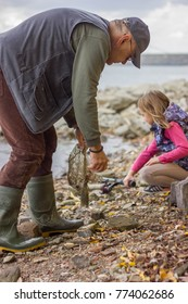 Grandfather and Granddaughter Fishing