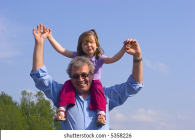 Grandfather and granddaughter are spending time together with love outdoors