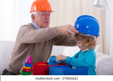 Grandfather and grandkid wearing helmets during play