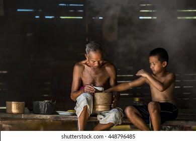 Grandfather and grandson eating at country home,countryside asia,